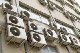 12584397-air-conditioning-units-on-exterior-of-public-building-energy-consumption-and-global-warming-concept