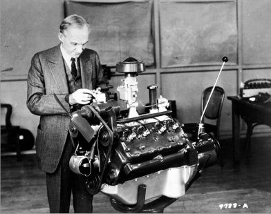 Henry Ford Looking at V-8 engine