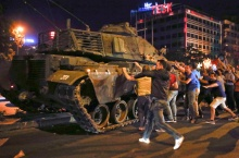 People react near a military vehicle during an attempted coup in Ankara, Turkey, July 16, 2016.     REUTERS/Tumay Berkin TPX IMAGES OF THE DAY