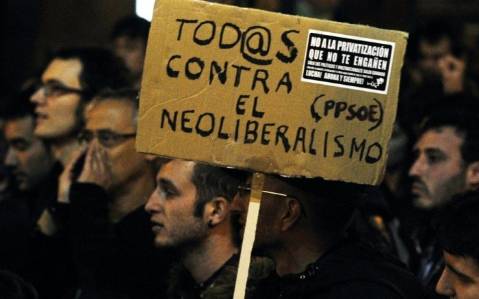 a-placard-reading-all-against-neolibera-133136838-574e533731d3d